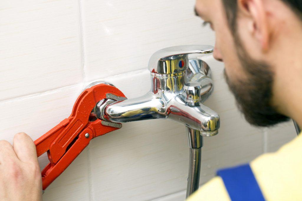 handyman fixing a sink