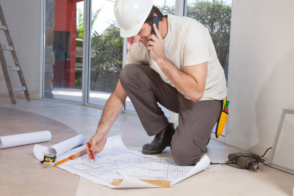 remodeling contractor worker on the phone